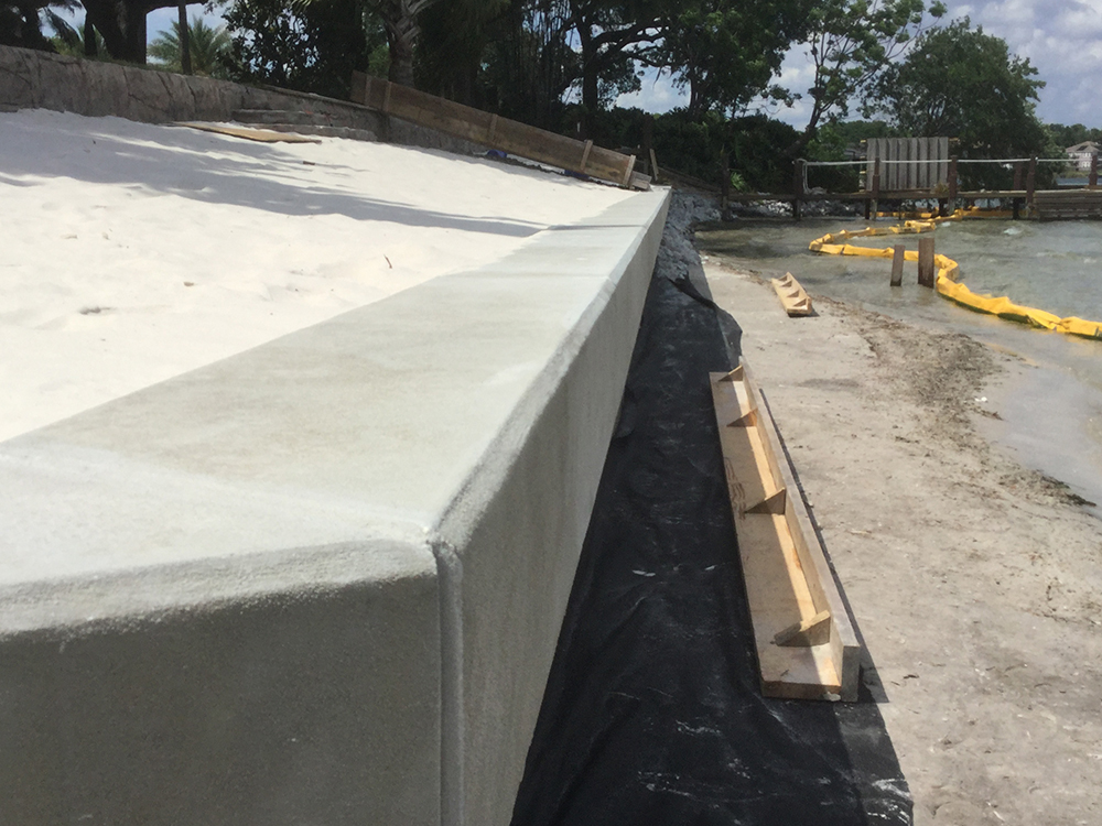 flat panel vinyl seawall with concrete cap