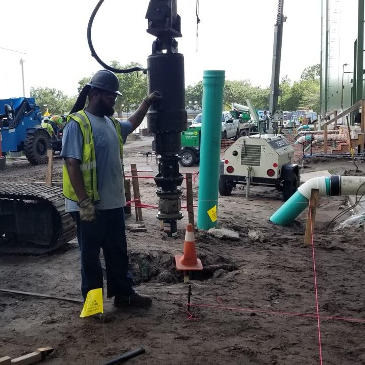 helical pile driving install